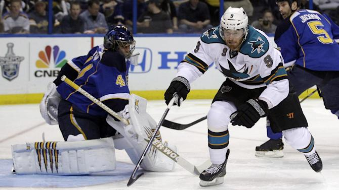 San Jose Sharks' Martin Havlat, right, of the Czech Republic, reaches for a loose puck as St. Louis Blues goalie Jaroslav Halak, of Slovakia, watches during the first period in Game 2 of an NHL Stanley Cup first-round hockey playoff series Saturday, April 14, 2012, in St. Louis. (AP Photo/Jeff Roberson)