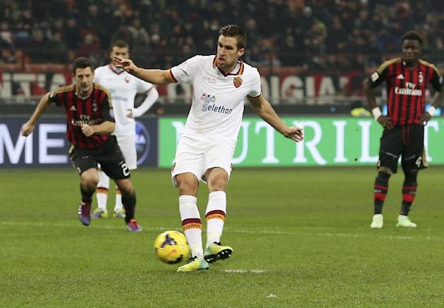AS Roma midfielder Kevin Strootman, of the Netherlands, scores on a penalty kick during the Serie A soccer match between AC Milan and Roma at the San Siro stadium in Milan, Italy, Monday, Dec. 16, 201