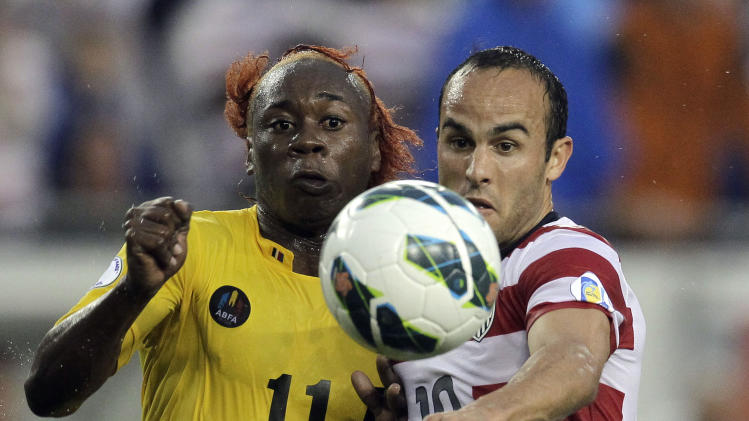 U.S. forward Landon Donovan (10) vies with Antigua and Barbuda midfielder Quinton Griffith (11) for the ball during the first half of a FIFA World Cup qualifying soccer game Friday, June 8, 2012, in Tampa, Fla. (AP Photo/Chris O'Meara)