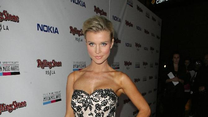 IMAGE DISTRIBUTED FOR NOKIA - Joanna Krupa arrives at the Rolling Stone American Music Awards After Party, on Sunday, Nov. 18, 2012 in Los Angeles. (Photo by Casey Rodgers/Invision for Nokia/AP Images)