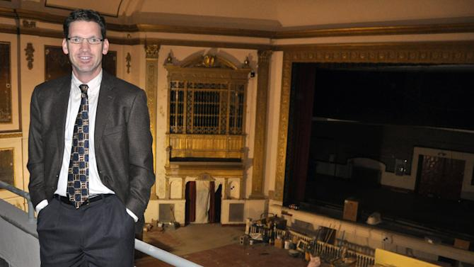 In this Nov. 17, 2012 photo Stephen Williamson, executive director of the State Theatre, shows the balcony view inside the historic downtown movie house under restoration in Sioux Falls, S.D. The circa-1926 theater, closed since 1991, has been raising funds for its eventual reopening and plans to begin showing movies again sometime in 2013. (AP Photo/Dirk Lammers)