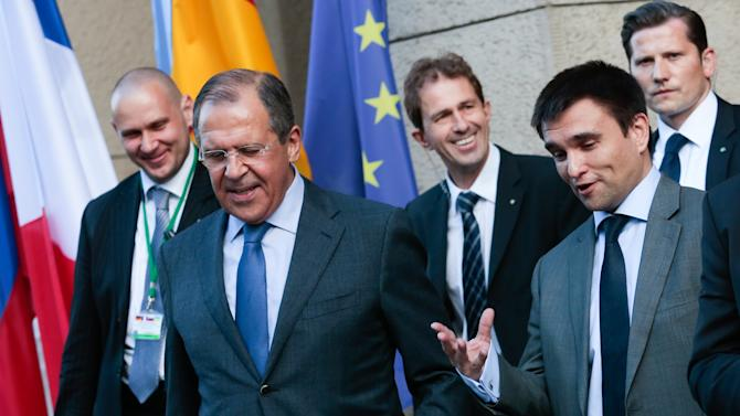 Ukrainian Foreign Minister Pavlo Klimkin, right, talks to Russian Foreign Minister Sergey Lavrov, second from left, as they leave the German Foreign Ministry for dinner together in Berlin, Wednesday, July 2, 2014. The foreign ministers from Germany, France, Ukraine and Russia meet in Berlin to keep searching for a way to de-escalate the conflict in Ukraine. (AP Photo/Markus Schreiber)