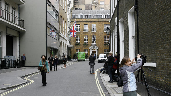 Members of the media observe chairman of News Corporation Rupert Murdoch's residence in central London, Monday, July 18, 2011. (AP Photo/Akira Suemori)