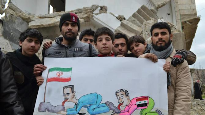 This citizen journalism image provided by Edlib News Network, ENN, which has been authenticated based on its contents and other AP reporting, shows anti-Syrian regime protesters holding a caricature placard mocking Syrian President Bashar Assad and his supporters during a demonstration, in the town of Kafr Nabil, Idlib province, northern Syria, Friday Jan. 11, 2013. Islamic militants seeking to topple President Bashar Assad took full control of a strategic northwestern air base Friday in a significant blow to government forces, seizing helicopters, tanks and multiple rocket launchers, activists said. (AP Photo/Edlib News Network ENN)