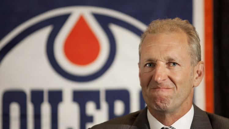 Ralph Krueger grimaces during a news conference where he was introduced as the new head coach of the Edmonton Oilers NHL hockey team in Edmonton, Alberta, Wednesday, June 27, 2012. (AP Photo/The Canadian Press, Jason Franson)