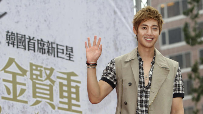 """FILE - In this Sunday, Aug. 14, 2011 file photo, South Korean singer Kim Hyun-joong smiles during his four-day tour in Taipei, Taiwan. Kim is preparing to kick off his """"2012 Asia Fan Meeting Tour"""" by high-fiving all 3,000 people expected to turn up - a first for a pop star visiting Singapore. The tour kicks off on Friday, May 4, 2012 and will include stops in Hong Kong, Taiwan, China and Thailand. (AP Photo/Chiang Ying-ying, File)"""