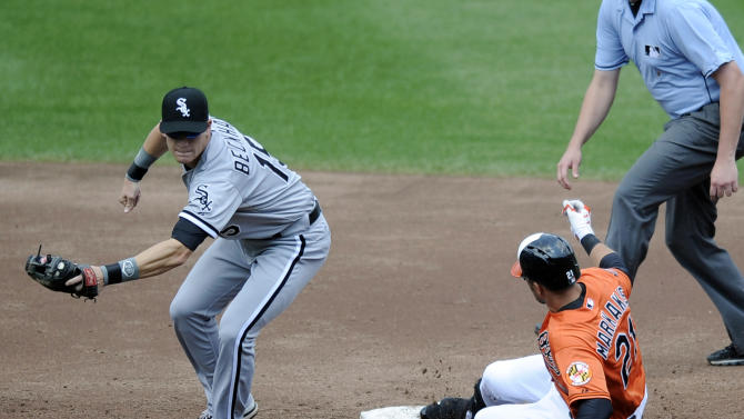 Baltimore Orioles' Nick Markakis (21) slides into second with a double against Chicago White Sox second baseman Gordon Beckham (15) during the third inning of a baseball game, Thursday, Aug. 30, 2012, in Baltimore. (AP Photo/Nick Wass)