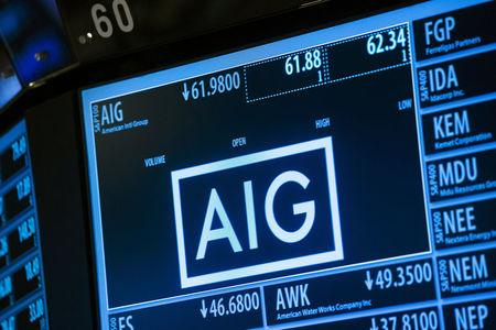 FILE PHOTO - Current information related to insurance company AIG is displayed above the floor of the New York Stock Exchange