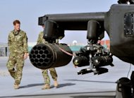 Britain's Prince Harry (L) is shown an Apache helicopter upon his arrival at Camp Bastion in Afghanistan, on September 7. Harry was moved under guard to a secure location during a Taliban attack on the camp last Friday, the base where he is deployed in Afghanistan, according to Britain's defence minister