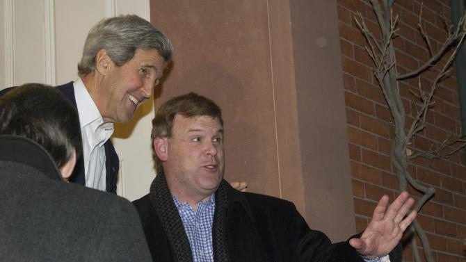 Kerry greets Baird at his home in Boston