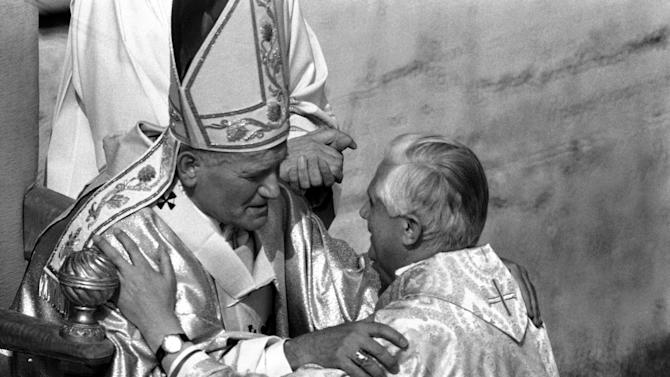 FILE - In this Oct. 22, 1978 file photo, Pope John Paul II places his hands on the shoulders of West German Cardinal Joseph Ratzinger, archbishop of Munich and Freising, during the solemn inauguration of his ministry as universal Pastor of the Church in Vatican City. Ratzinger, who later became Pope Benedict XVI, announced Monday, Feb. 11, 2013 that he will resign on Feb. 28. The 85-year-old pope announced his decision in Latin during a meeting of Vatican cardinals. (AP Photo)