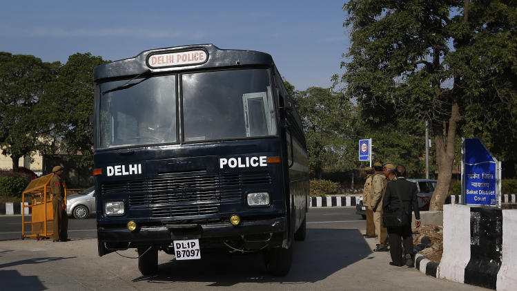 A Delhi police van, believed to be carrying the accused in a gang rape of a 23-year-old woman, enters a district court n New Delhi, India, Monday, Jan. 21, 2013. Legal proceedings in the fatal gang-rape attack on a student in India's capital were set to begin Monday in a fast-track court for crimes against women that has stirred debate over how best to deliver justice to rape victims. (AP Photo/Saurabh Das)