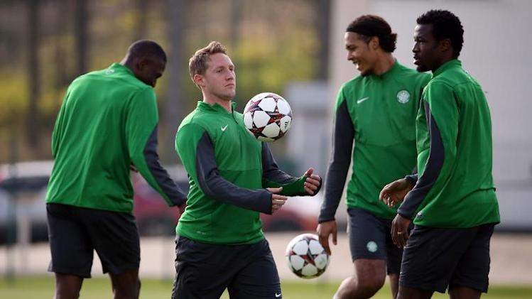 Celtic's striker Kris Commons (2ndL) controls a ball during a training session at Lennoxtown Training facility, near Glasgow, Scotland, on September 30, 2013