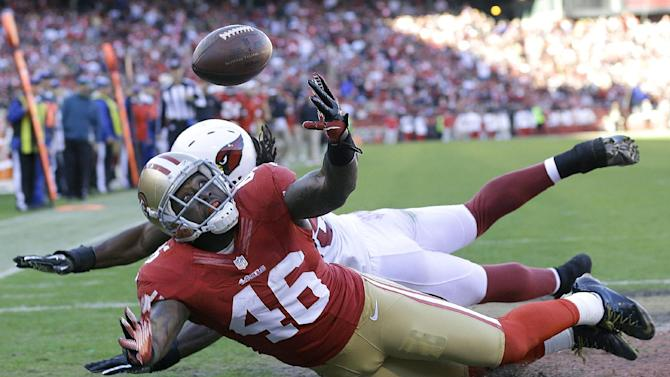 San Francisco 49ers tight end Delanie Walker (46) cannot catch a pass in the end zone against the Arizona Cardinals during the third quarter of an NFL football game in San Francisco, Sunday, Dec. 30, 2012. (AP Photo/Marcio Jose Sanchez)
