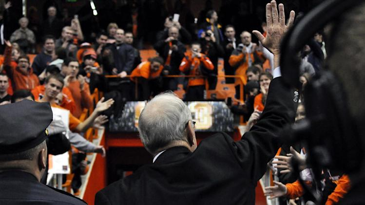Syracuse head coach Jim Boeheim acknowledges fans after his team defeated Rutgers 78-53 for his 903rd career victory passing Bobby Knight in an NCAA college basketball game in Syracuse, N.Y., Wednesday, Jan. 2, 2013. (AP Photo/Kevin Rivoli)