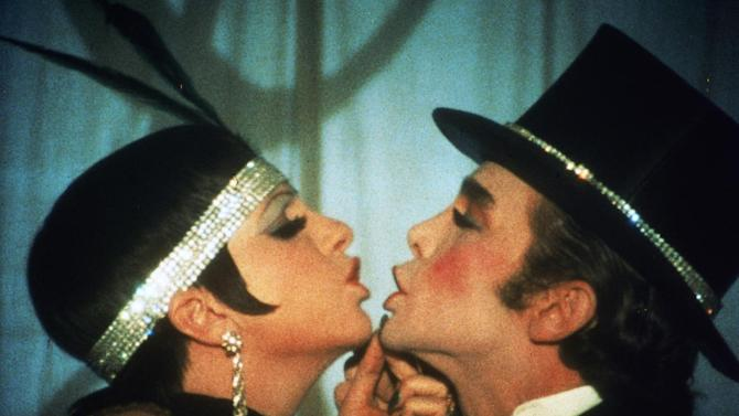 "This 1972 photo released by Warner Bros. Home Video shows Liza Minnelli as Sally Bowles, left, and Joel Grey as Master of Ceremonies in a scene from ""Cabaret.""  The landmark film ""Cabaret"", starring Liza Minnelli, Joel Grey and Michael York, has turned 41. All three actors will be attending an anniversary celebration screening planned Thursday, Jan. 31, 2013, at the Ziegfeld Theatre, where the movie first premiered in 1972. (AP Photo/Warner Bros. Home Video)"