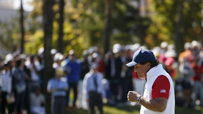 U.S. team member Mickelson reacts after missing a putt on the second green during the four ball matches of the 2015 Presidents Cup golf tournament in Incheon