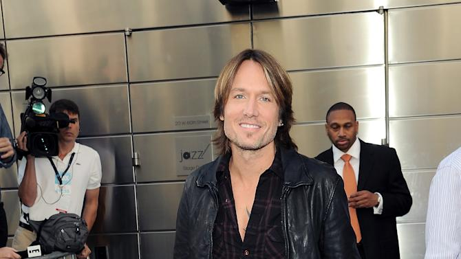 """American Idol"" Season 12 judge Keith Urban arrives for day one auditions at Jazz at Lincoln Center on Sunday, Sept. 16, 2012 in New York. (Photo by Evan Agostini/Invision/AP)"