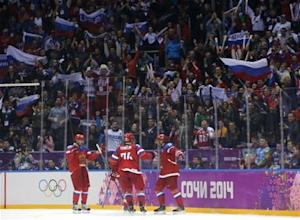 Russia's Kovalchuk celebrates his goal against Norway with teammates Yemelin and Radulov during the second period of their men's qualification round ice hockey game at the 2014 Sochi Winter Olympic Games