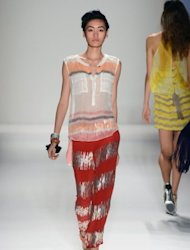 A model walks the runway at the Tracy Reese spring 2013 fashion show for TRESemme during New York fashion week at The Studio at Lincoln Center in New York City. Reese capitalized on her high-profile sartorial relationship with First Lady Michelle Obama with a sparkling show Sunday that paid homage to every woman's inner nerd