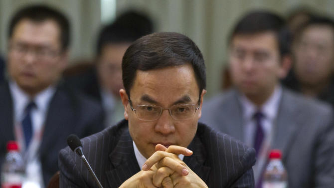 Li Hejun, chairman and CEO of Hanergy Group, attends a press conference held at the company's headquarters in Beijing, China, Wednesday, Jan. 9, 2013. The Chinese company that bought Miasole, a California producer of thin-film solar panels, says it can make a success of the emerging technology where others have suffered huge losses. (AP Photo/Alexander F. Yuan)
