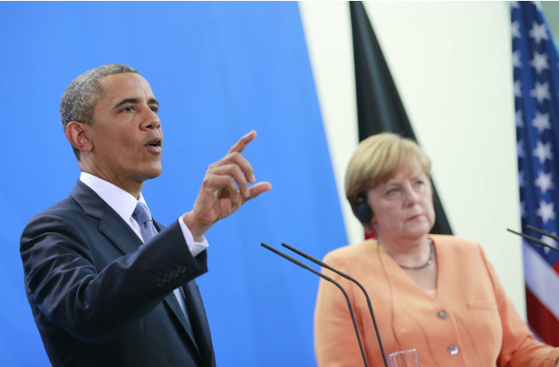 U.S. President Obama speaks next to German Chancellor Merkel during news conference at Chancellery in Berlin