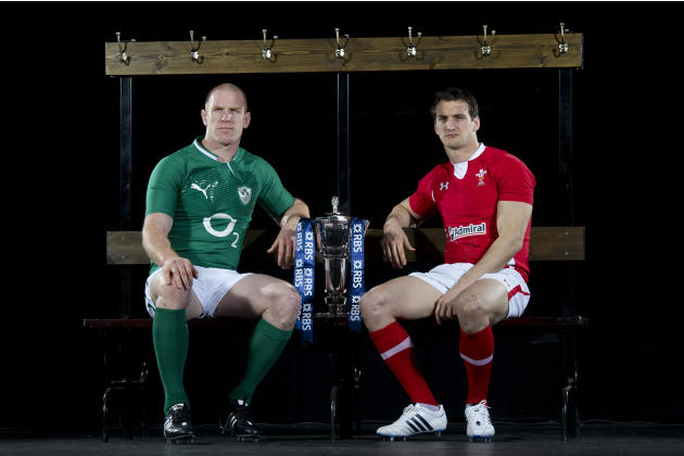 Ireland captain Paul O' Connell (L) and Wales captain Sam Warburton (R) pose for photographers flanking the trophy during the launch of the Six Nations Rugby Championship in London on January 25, 2012