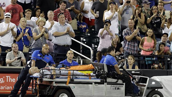Atlanta Braves' Tim Hudson is carted off the field after being injured during the eighth inning of a baseball game against the New York Mets, Wednesday, July 24, 2013, in New York. (AP Photo/Frank Franklin II)