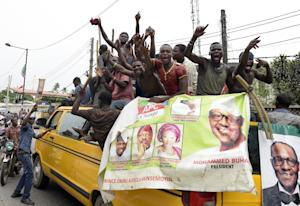 Supporters of Muhammadu Buhari celebrate his election …