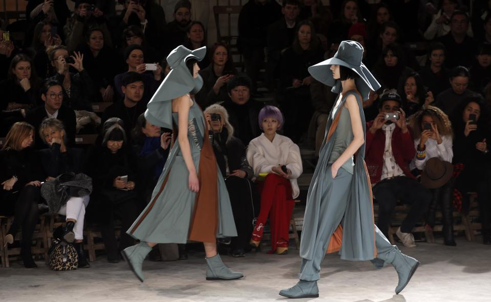 Models wear creations by Japanese fashion designer Yohji Yamamoto for his Fall/Winter 2013-2014 ready to wear collection, in Paris, Friday, March 1, 2013. (AP Photo/Christophe Ena)