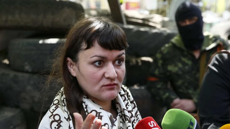 Ukrainian journalist Irma Krat speaks with journalists in Slaviansk