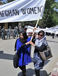 Afghan women hold banners as they demonstrate in Kabul against the the recent public execution of a young woman for alleged adultery, in Kabul on July 11, 2012. Dozens of Afghan women's rights activists took to the streets July 11 to protest the recent public execution of a young woman for alleged adultery, which was captured in ahorrific video. AFP PHOTO/Massoud HOSSAINI