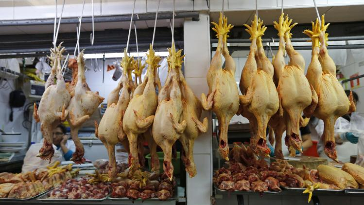 Chickens hang on display at stalls in the Central Market in downtown Lima