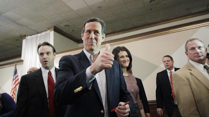 Republican presidential candidate, former Pennsylvania Sen. Rick Santorum gives a thumbs up to a supporter at the Livonia Chamber of Commerce breakfast, Monday, Feb. 27, 2012, in Livonia, Mich.  (AP Photo/Eric Gay)