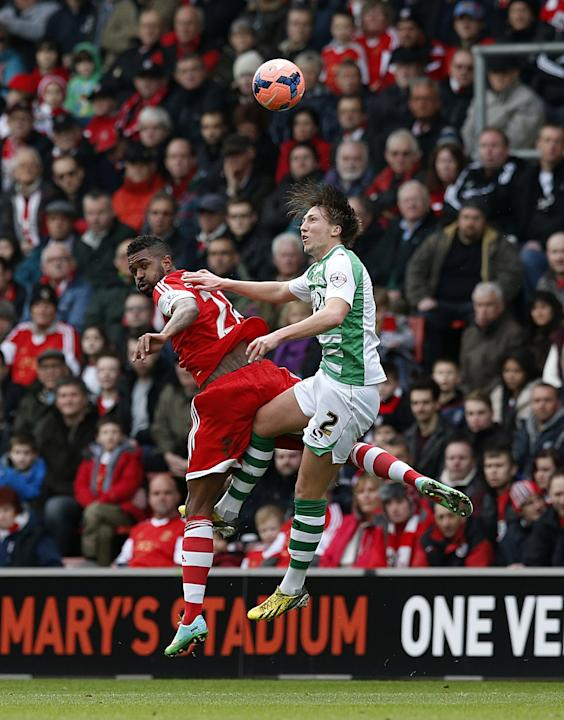 Yeovil Town's Luke Ayling, right, and Southampton's Guly Do Prado battle for the ball during their FA Cup fourth round soccer match at St Mary's, Southampton, England, Saturday, Jan. 25, 2