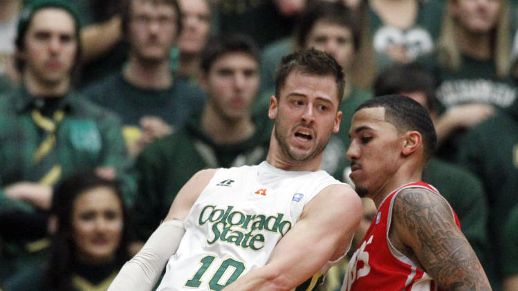 Colorado State guard Wes Eikmeier, left, loses control of the ball while covered by New Mexico guard Kendall Williams in the second half of New Mexico's 91-82 victory in an NCAA basketball game in Fort Collins, Colo., on Saturday, Feb. 23, 2013. (AP Photo/David Zalubowski)