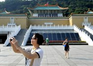 This file photo shows a tourist taking photos outside Taipei's National Palace Museum, in 2010. The museum has been fined for preventing a woman from breastfeeding, the first such case since a law was enacted to protect the right to breastfeed in public, authorities said on Tuesday