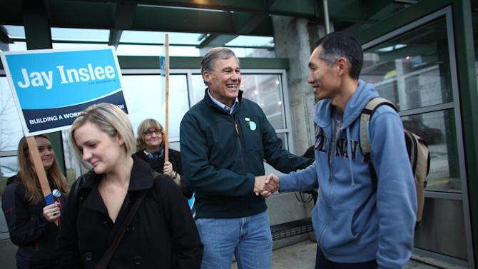 Democratic candidate for Washington State Governor, Jay Inslee, shakes hands at the Eastgate Park-and-Ride in Bellevue, Wash. on Election Day, Tuesday, Nov. 6, 2012. (AP Photo/seattlepi.com,  Joshua Trujillo)