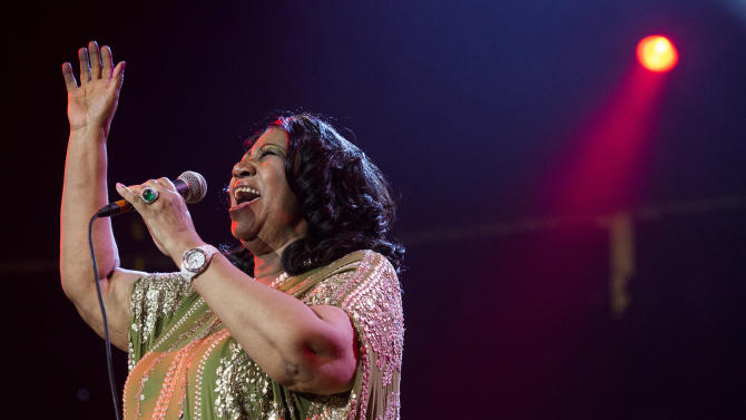 In this Saturday, May 11, 2013 photo, Aretha Franklin performs during McDonald's Gospelfest 2013 at the Prudential Center in Newark, N.J.  Franklin has canceled performances in Chicago on May 20 and Connecticut on May 26 under a doctor's recommendation for treatment. It's unclear what she's being treated for.  (Photo by Charles Sykes/Invision/AP, File)