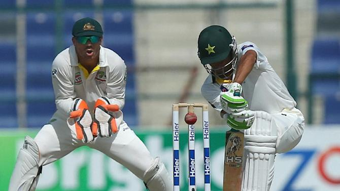 Pakistan's Younis Khan (R) bats on the second day of the second Test against Australia at Zayed International Cricket Stadium in Abu Dhabi on October 31, 2014