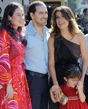 File-This Oct. 22, 2011 file photo shows Salma Hayek, right, her daughter Valentina Pinault, and her brother Sami Hayek, center, with Daniela Villegas, left, arrive at a premiere at The Regency Village Theater in Westwood, Calif. Sami Hayek was hospitalized with broken ribs after being involved in a Los Angeles car crash that killed his passenger on Sunday Feb. 23, 2014. (AP Photo/Katy Winn,File)