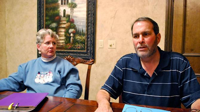 In this Nov. 29, 2012 photo, Dennis O'Brien, right, talks about his health after getting fungal meningitis while his wife, Kaye O'Brien, left, listens in Nashville, Tenn. Dennis O'Brien contracted fungal meningitis after receiving a series of steroid injections in his neck made by a Massachusetts pharmacy that has been linked to an outbreak of fungal meningitis. (AP Photo/Kristin M. Hall)