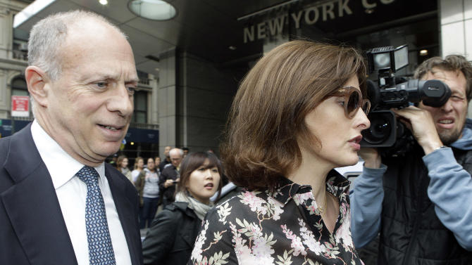 Supermodel Linda Evangelista, right, leaves Manhattan Family Court Thursday, May 3, 2012, in New York. Evangelista is demanding that ex-boyfriend Francois-Henri Pinault pay child support for their 5-year-old son. (AP Photo/Frank Franklin II)