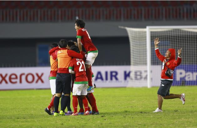 Indonesia's team celebrates after beating Malaysia during SEA Games in Naypyitaw