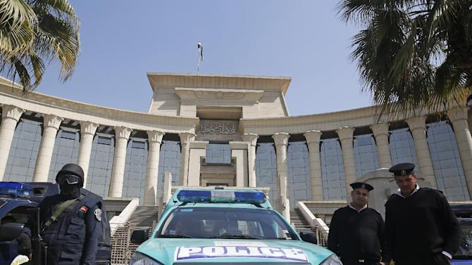 Members of the special forces police stand guard in front of the Supreme Constitutional Court in Cairo