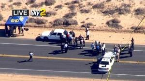 This video image provided by KCBS-TV shows the site of s shooting Friday Oct. 25, 2013 ion Ridgecrest, Calif. A homicide suspect was killed by police on this Mojave Desert highway early Friday after a lengthy pursuit in which the man fired at vehicles and two hostages in his car trunk, authorities said.(AP Photo/KCBS-TV)