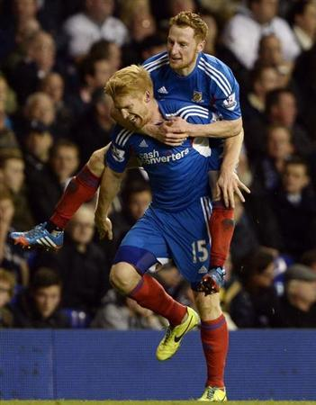 Hull City's McShane celebrates his goal against Tottenham Hotspur with Quinn during their English League Cup fourth round soccer match in London