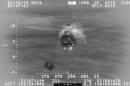 In this early Monday, Jan. 26, 2015 photo from video provided by the U.S. Coast Guard, a Coast Guard MH-65 Dolphin helicopter crew hoists four passengers from the water about 11 miles off the coast of Oahu, Hawaii, after their single-engine Cessna crash landed after running out of fuel Sunday evening. (AP Photo/U.S. Coast Guard)