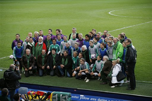 Wolfsburg players pose for a group photograph after training at Stamford Bridge Stadium in London Wednesday, May 22, 2013.  Wolfsburg will play Olympique Lyonnais in the Women's Champions League final