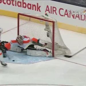 Steve Mason stops a flurry of shots